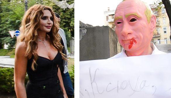 «Ганьба!» від активістів, «Танцюй!» від їхніх опонентів. Як Оксану Марченко під музеєм зустрічали